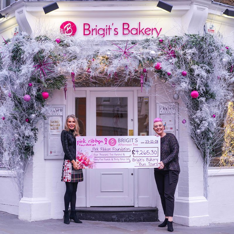 Brigit from B Bakery presenting the cheque with donations raised from our Pink Ribbon Bus Tour